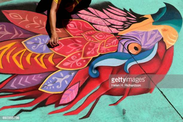 Artist Emily Pugmire works on a piece inspired by Mexican street artist Farid Rueda during the 15th annual Denver Chalk Art festival on Larimer...