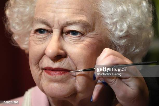 Artist Emma Meehan applies final touches on a new waxwork of Queen Elizabeth II at Madame Tussauds, Blackpool, on October 14, 2021 in Blackpool,...