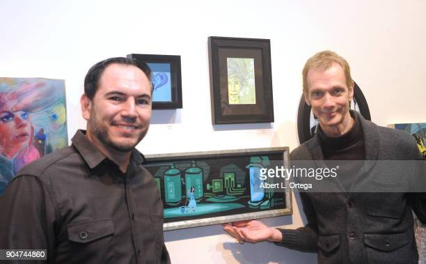 Artist Eric Gonzales poses with actor Doug Jones at Guillermo Del Toro's Art Show 'In The Name Of The Monster The Robot And The Bleeding Ghost'...