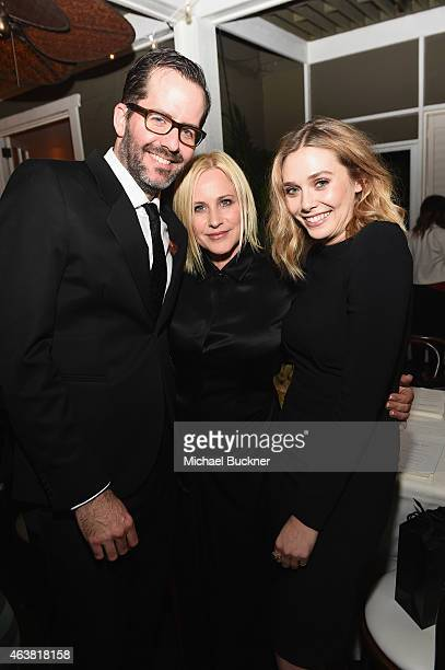 Artist Eric White and actors Patricia Arquette and Elizabeth Olsen attend VANITY FAIR and Barneys New York Dinner benefiting OXFAM hosted by Rooney...