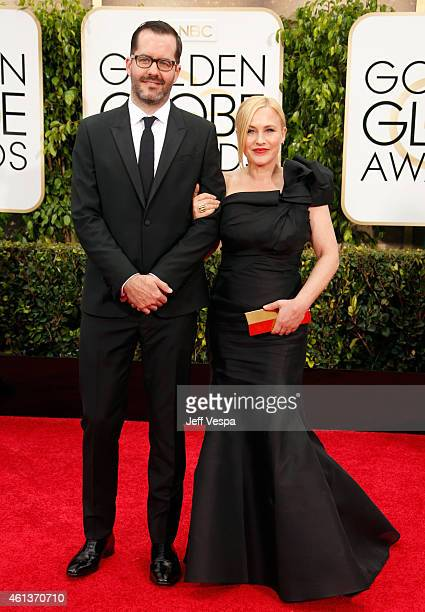 Artist Eric White and actress Patricia Arquette attend the 72nd Annual Golden Globe Awards at The Beverly Hilton Hotel on January 11 2015 in Beverly...