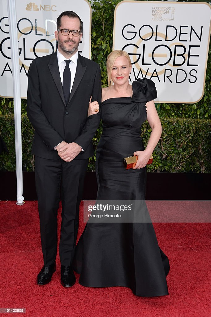 Artist Eric White and actress Patricia Arquette attend the 72nd Annual Golden Globe Awards at The Beverly Hilton Hotel on January 11, 2015 in Beverly Hills, California.