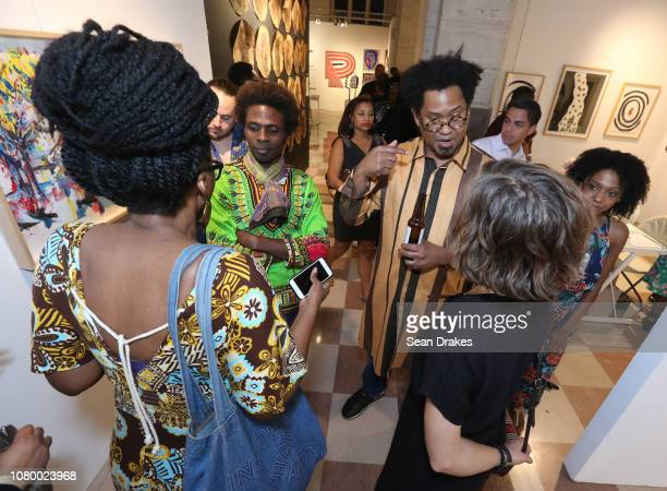 Artist Felandus Thames of Connecticut talks with guests at the 2018 PRIZM Art Fair as part of Art Basel Miami Beach on December 9 2018 in Miami...
