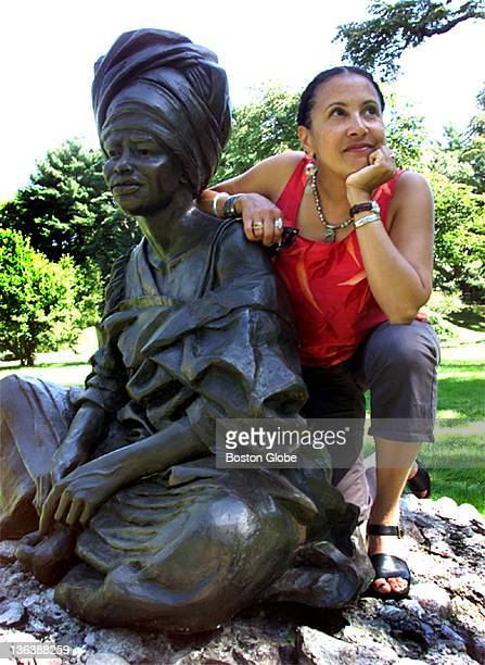 Artist Fern Cunningham of Boston with her sculpture 'The Sentinal' which will be on the sculpture path at Forest Hills Cemetery The display opens...