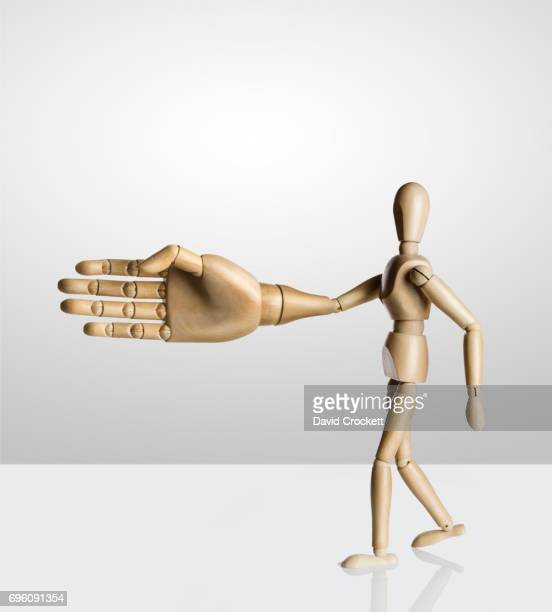 Artist figure with a very large hand