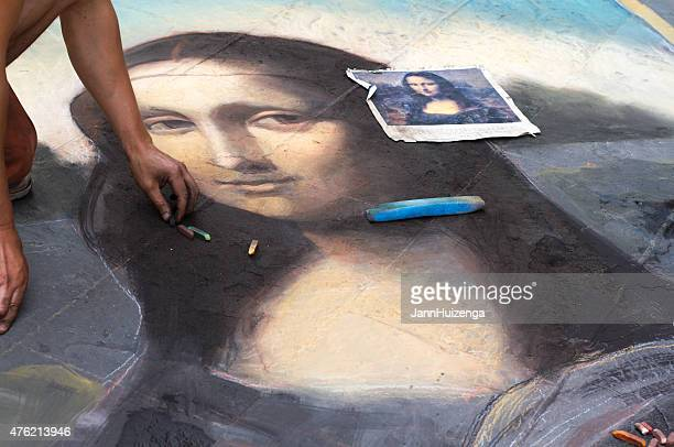 artist finishing sidewalk chalk drawing of mona lisa, florence, italy - chalk art equipment stock pictures, royalty-free photos & images