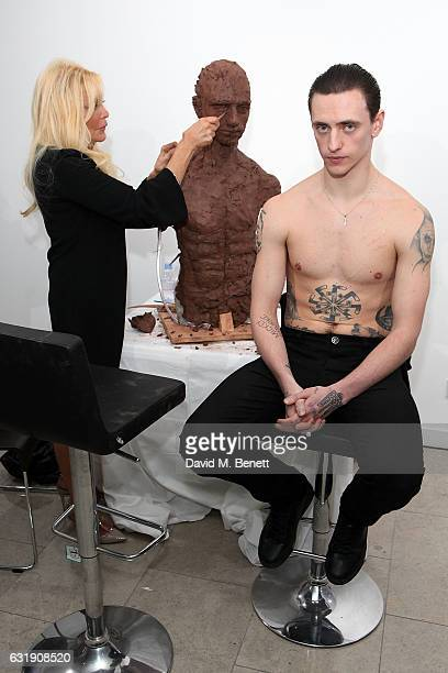 Artist Frances Segelman sculpts dancer Sergei Polunin at The Hospital Club Gallery on January 17, 2017 in London, England.