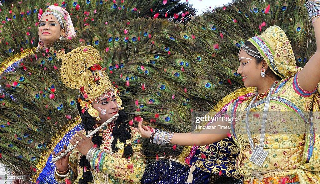 Artist from Shri Giriraj Krishna Sanskritik Kala Samiti performing Mayur Nratya dance during the Teej celebration function at Haryana Raj Bhawan on...