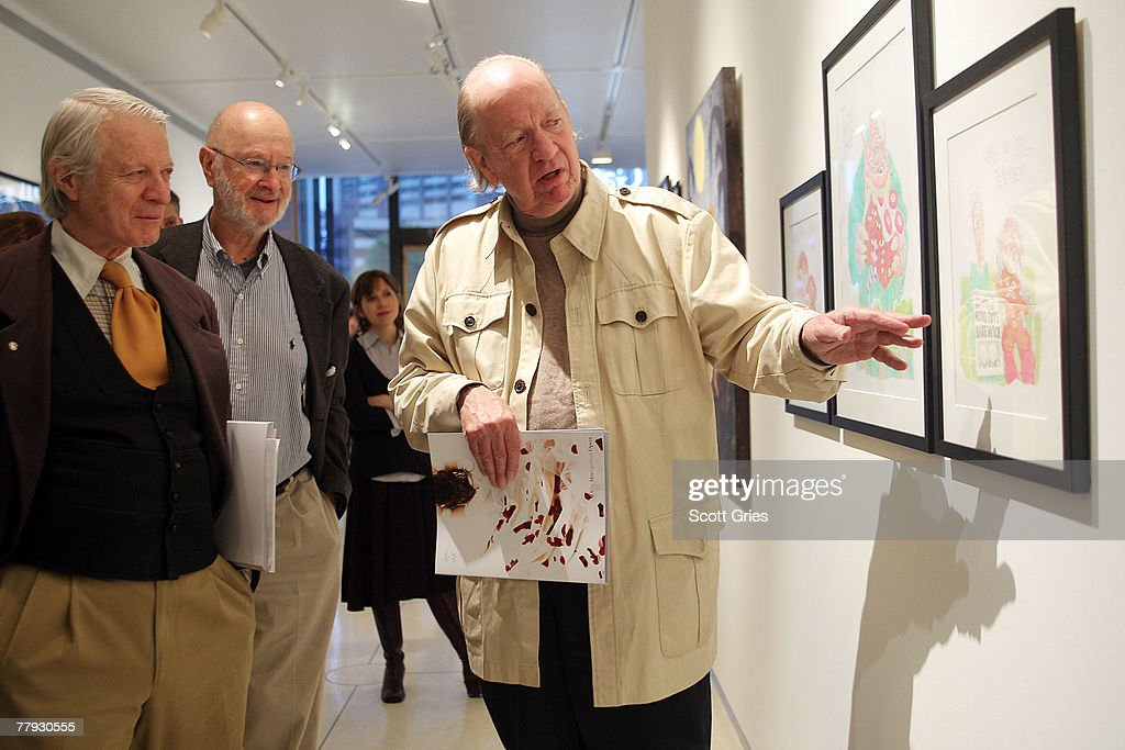 Artist Gahan Wilson (R) discusses his piece on display during a press preview of the Metropolitan Opera's and The New Yorker's exhibition of 'Hansel and Gretel' at the Arnold & Marie Schwartz Gallery Met on November 15, 2007 in New York City.