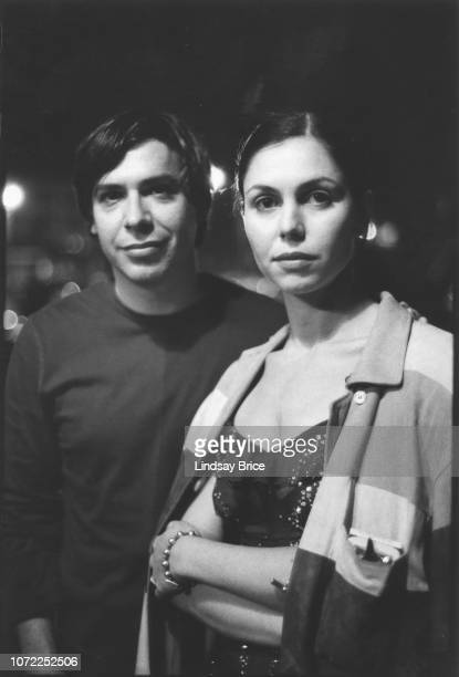 Artist George Condo and Anna Condo backstage at the Allen Ginsberg Memorial at the Wadsworth Theatre on June 21 1997 in Los Angeles California