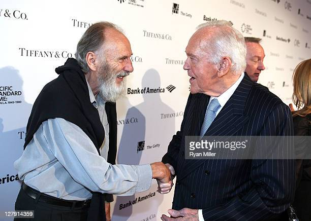 Artist George Herms and Henry Segerstrom greet during the Pacific Standard Time Art in LA 19451980 opening event held at the Getty Center on October...