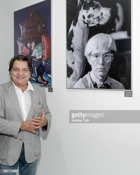 Artist Gianfranco Gorgoni poses with his artwork during the Clen Gallery Art Exhibition at Rogue Space on October 17 2013 in New York City