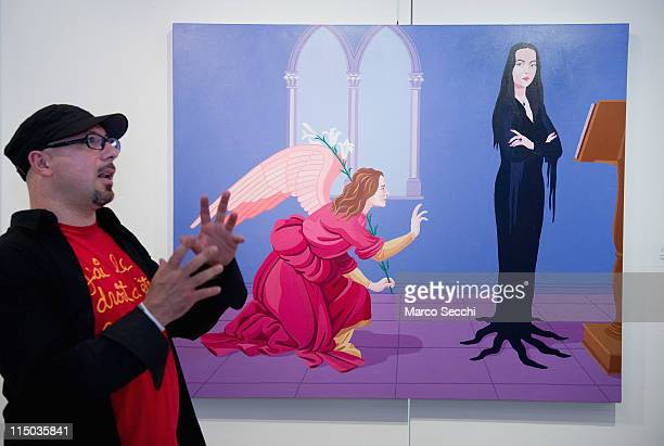 Artist Giuseppe Veneziano stands in front of one of his works at Galleria Contini on June 1 2011 in Venice Italy