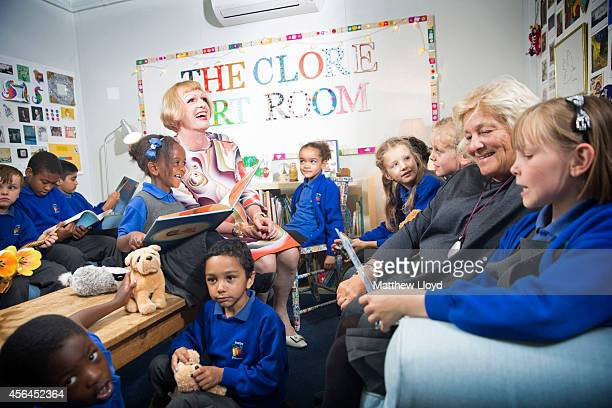 Artist Grayson Perry and Dame Vivien Duffield meet children from the Barlby Primary School in the Clore Art Room on October 1 2014 in London England...