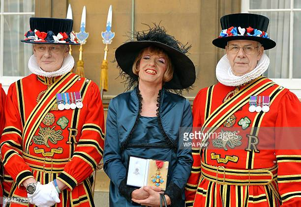 Artist Grayson Perry holds his CBE presented to him by the Prince of Wales during an investiture ceremony at Buckingham Palace on January 24 2014 in...