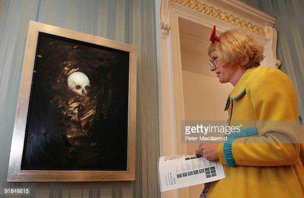 Artist Grayson Perry looks at the 'No Love Lost Blue Paintings by Damien Hirst' exhibition at The Wallace Collection on October 13 2009 in London The...