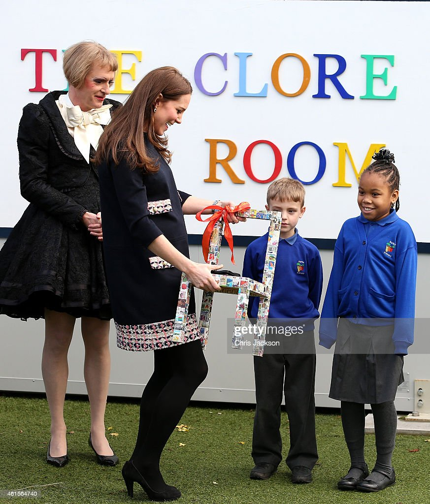 Artist Grayson Perry looks on as Catherine, Duchess of Cambridge is presented with a childs chair during a visit to Barlby Primary School on January 15, 2015 in London, England. The Duchess of Cambridge is visiting the Clore Art Room at Barlby School to support the charity 'The Art Room' of which she is patron.