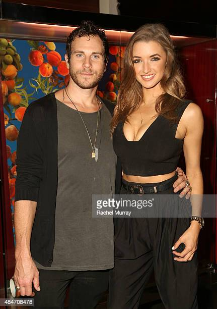 Artist Gregory Siff and Alyssa Arce attend Los Angeles Confidential Magazine's Art of the City celebration at SLS Hotel on August 20 2015 in Beverly...