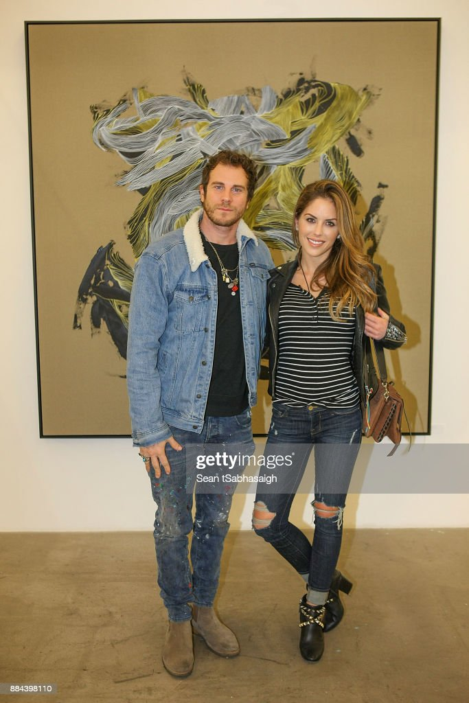 Artist Gregory Siff and Brittany Palmer pose at OptiMystic: A Brandon Boyd Pop Up Gallery Featuring He, Tasya Van Ree, Natalie Bergman, Diana Garcia And DJ Set By Brent Bolthouse at 101/Exhibit Gallery on December 1, 2017 in West Hollywood, California.