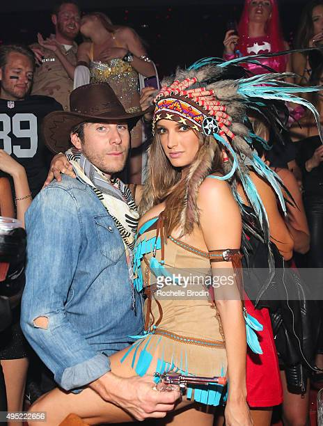 Artist Gregory Siff and supermodel Alyssa Arce attend the Trick or Treats 2015 Forbidden Ball event at Light night club on October 31 2015 in Las...