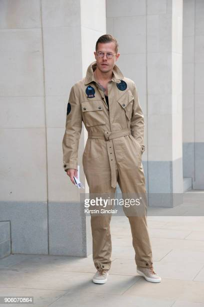 Artist Greogroy Emvy wears Richard James trainers Grenfell jumpsuit and Bob Sdrunk glasses day 1 of London Mens Fashion Week Autumn/Winter 2018 on...