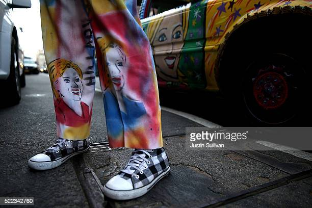Artist Gretchen Baer wears a custom made pant suit with images of democratic presidential candidate Hillary Clinton outside of a campaign event on...