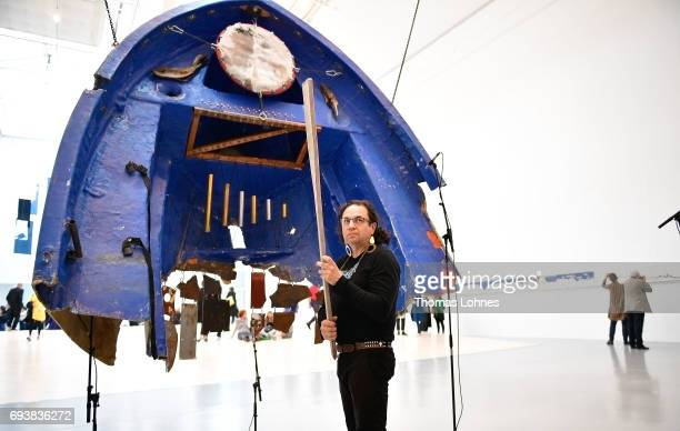 Artist Guilermo Galindo performs with his artwork 'Sonic Borders 2' at 'documenta hall' on June 8 2017 in Kassel Germany The documenta 14 is the...