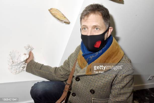 """Artist Guillaume Pinard poses with his work during """"Ils Ont Dit Oui"""" Exhibition an Amalteo Institute Project Curated by Marc Molk at Galerie..."""