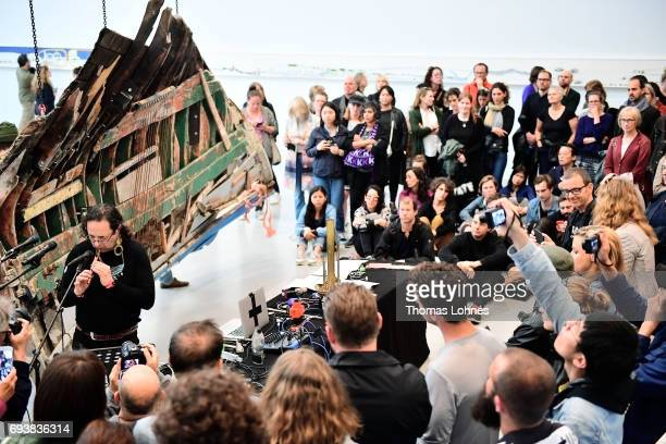 Artist Guillermo Galindo of Mexico performs with his artwork 'Sonic Borders 2' at 'documenta hall' on June 8 2017 in Kassel Germany The documenta 14...