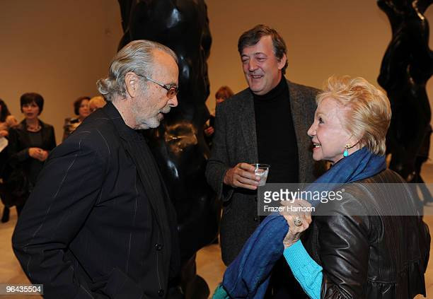 Artist Herb Alpert Stephen Fry actor and Pat York photographer attend the Black Totem Series Artist Reception held at Ace Gallery on February 4 2010...