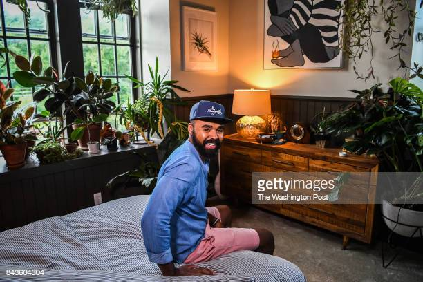 Artist Hilton Carter photographed in his apartment on Wednesday August 30 in Baltimore MD Carter turned his home into a kind of urban greenhouse and...