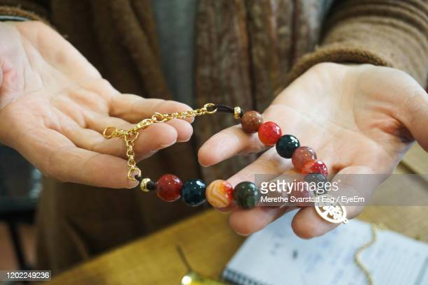 artist holding handmade jewelry - bead stock pictures, royalty-free photos & images