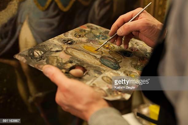 artist holding painter's palette