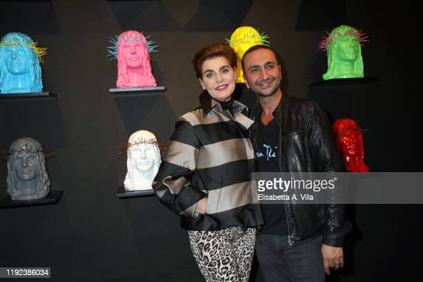 Artist Howtan Re and Antonia Dell'Atte attend the Howtan Re Preview Party at Howtan Space on December 06 2019 in Rome Italy