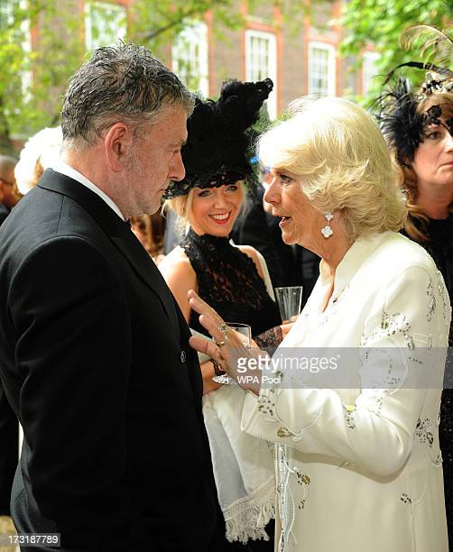 Artist Jack Vettriano meets with Camilla Duchess of Cornwall at a reception hosted by Prince Charles Prince of Wales and Duchess of Cornwall a...