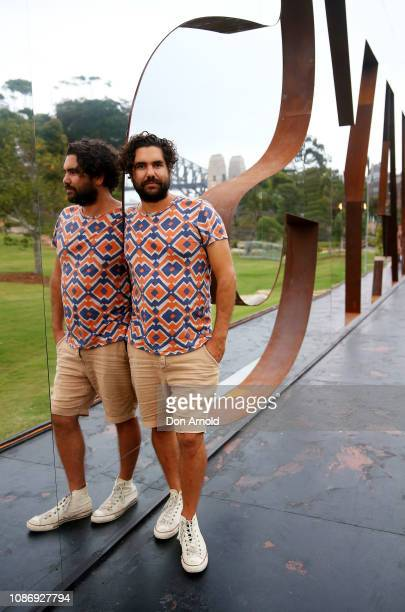 Artist Jacob Nash poses within his largescale outdoor sculpture spelling ALWAYS from the declaration 'Always was always will be Aboriginal land'â by...