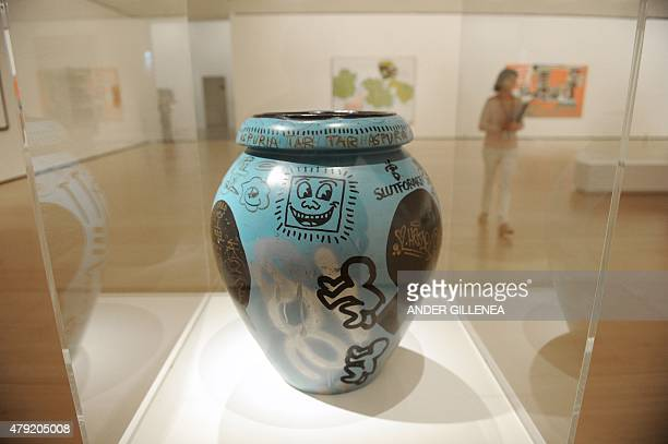 """Artist Jean-Michel Basquiat's artwork done with the collaboration of US artists Keith Haring and Kenny Scharf titled """"Untitled"""" is seen during the..."""