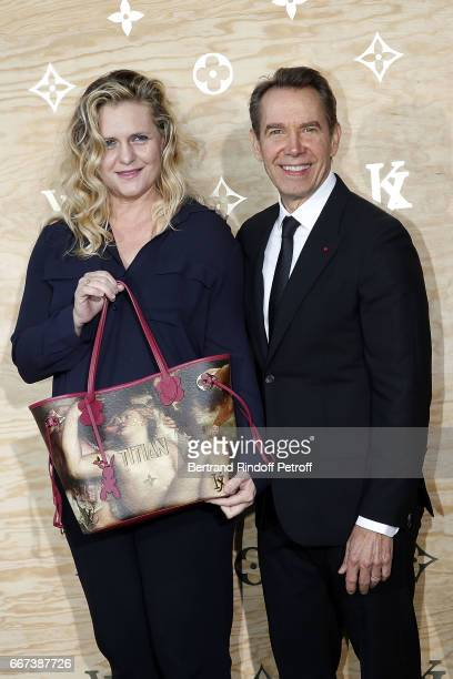 Artist Jeff Koons and his wife Justine Wheller Koons attend the LVxKOONS exhibition at Musee du Louvre on April 11 2017 in Paris France