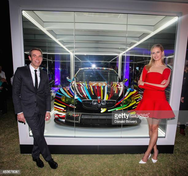Artist Jeff Koons and supermodel and actress Karolína Kurková unveil the North American premiere of the BMW Art Car by Jeff Koons in the Miami Beach...
