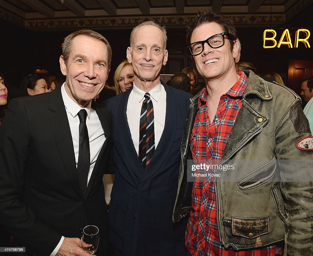 Artist Jeff Koons, director John Waters and actor Johnny Knoxville attend the Dom Perignon Reception after The Un-Private Collection: Jeff Koons and John Waters in Conversation at Orpheum Theatre on February 24, 2014 in Los Angeles, California.