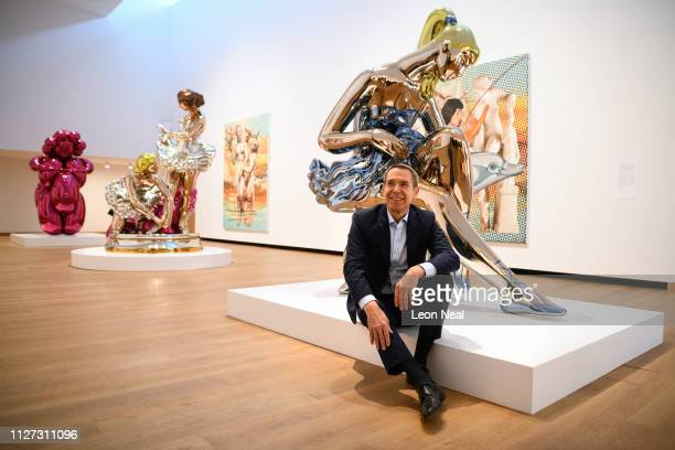 US artist Jeff Koons poses with a number of his works including Seated Ballerina for photographers during the press launch of an exhibitions of his...