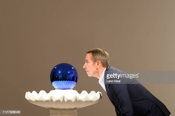 US artist Jeff Koons poses with Gazing Ball for photographers during the press launch of an exhibitions of his work at the Ashmolean Museum on...