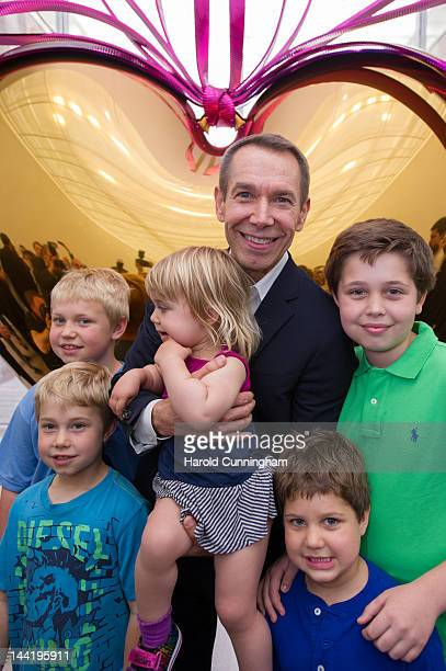 Artist Jeff Koons poses with his children during the 'Jeff Koons' exhibition preview at the Fondation Beyeler on May 11 2012 in Basel Switzerland...