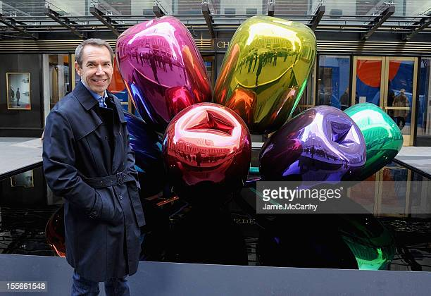 Artist Jeff Koons poses with his sculpture Tulips in front of Christie's at Rockefeller Plaza on November 6 2012 in New York City