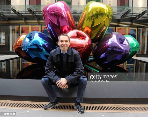 Artist Jeff Koons poses with his sculpture 'Tulips' in front of Christie's at Rockefeller Plaza on November 6 2012 in New York City
