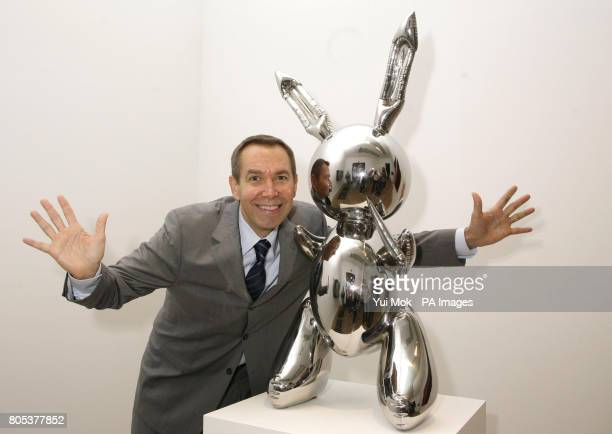 Artist Jeff Koons posing next to his work 'Rabbit' during a press preview of the exhibition Pop Life Art in a Material World at Tate Modern in London