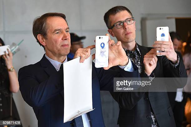 Artist Jeff Koons takes a photo on a Google phone showcasing his design on the case at the Jeff Koons x Google launch on May 09 2016 in New York New...