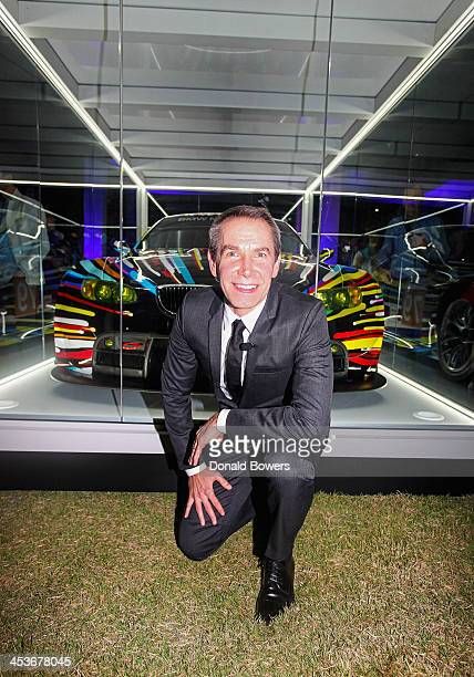 Artist Jeff Koons unveils the North American premiere of his BMW Art Car in the Miami Beach Botanical Gardens as part of Art Basel on December 4 2013...
