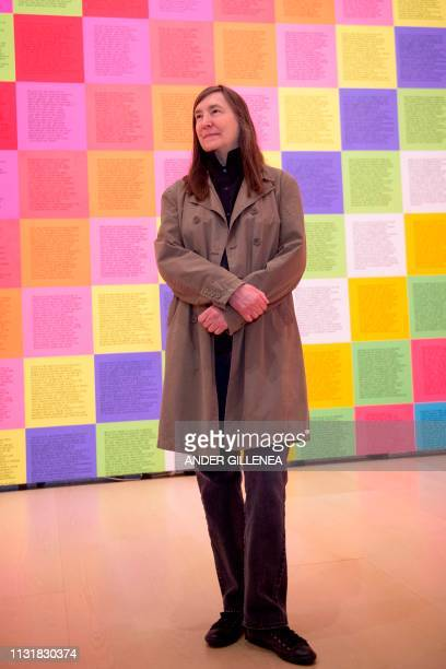 US artist Jenny Holzer poses in front of her artwork 'Inflammatory Wall' during a presentation of the 'Jenny Holzer Thing Indescribable' exhibition...