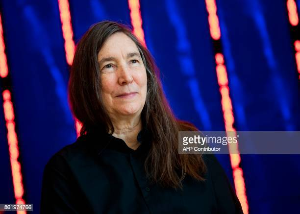 US artist Jenny Holzer poses next to her artwork Installation for Bilbao at the Guggenheim Museum in the northern Spanish Basque city of Bilbao on...